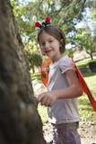 Retrato de la muchacha en traje de la mariquita Imagenes de archivo