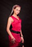 Retrato de la muchacha en una alineada roja Imagen de archivo libre de regalías
