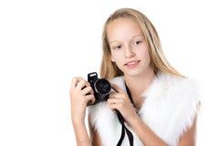 Retrato de la muchacha feliz con la cámara Imagen de archivo