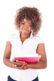 Retrato de la muchacha hermosa del estudiante con los libros Foto de archivo libre de regalías