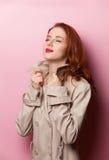 Retrato de la muchacha hermosa del redhead Imagen de archivo libre de regalías