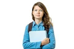 Retrato de la muchacha joven del estudiante con los libros y la mochila Fotografía de archivo libre de regalías