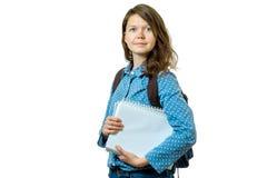 Retrato de la muchacha joven del estudiante con los libros y la mochila Imagen de archivo libre de regalías