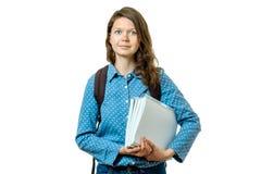 Retrato de la muchacha joven del estudiante con los libros y la mochila Fotografía de archivo