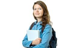 Retrato de la muchacha joven del estudiante con los libros y la mochila Fotos de archivo libres de regalías