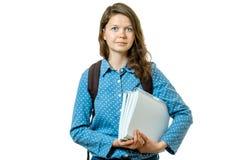 Retrato de la muchacha joven del estudiante con los libros y la mochila Fotos de archivo