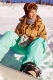 Retrato de la muchacha joven del snowboarder Fotografía de archivo