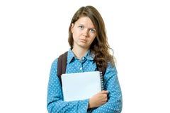 Retrato de la muchacha joven triste del estudiante con los libros Imágenes de archivo libres de regalías