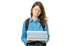 Retrato de la muchacha joven triste del estudiante con los libros Foto de archivo