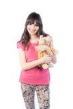 Retrato de la muchacha linda con un juguete suave en las manos aisladas en el fondo blanco Fotos de archivo libres de regalías
