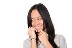 Retrato de la muchacha sonriente que mira a un lado Fotografía de archivo libre de regalías