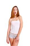 Retrato de la muchacha sorprendida en el fondo blanco Foto de archivo libre de regalías