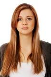 Retrato de la mujer adolescente con la cara seria Imagenes de archivo