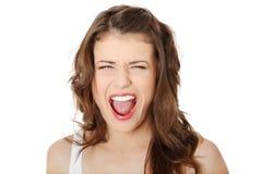 Retrato de la mujer adolescente joven enojada Imagenes de archivo