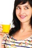 Retrato de la mujer con el zumo de naranja imagen de archivo libre de regalías