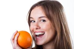 Retrato de la mujer con la naranja Fotografía de archivo