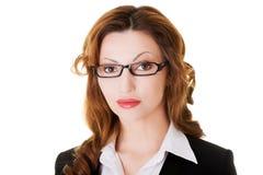 Retrato de la mujer de negocios atractiva en vidrios del ojo. Imagenes de archivo