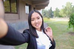 Retrato de la mujer de negocios hermosa asiática joven, muchacha femenina ho fotografía de archivo libre de regalías
