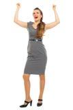 Retrato de la mujer de negocios que celebra la victoria Fotografía de archivo