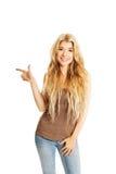 Retrato de la mujer del estudiante que señala a la izquierda Imagen de archivo