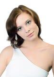 Retrato de la mujer en el backout blanco Fotos de archivo