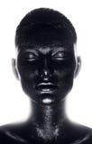 Retrato de la mujer en pintura negra en luz imagen de archivo libre de regalías