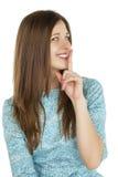 Retrato de la mujer joven atractiva con el finger en los labios Fotos de archivo