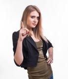 Retrato de la mujer joven atractiva con su dedo para arriba Imágenes de archivo libres de regalías