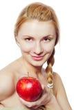 Retrato de la mujer joven con la manzana roja Imagen de archivo libre de regalías