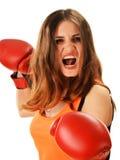Retrato de la mujer joven con los guantes de boxeo rojos Fotos de archivo libres de regalías