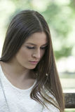 Retrato de la mujer joven con una mirada triste Fotografía de archivo libre de regalías