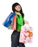 Retrato de la mujer joven del beautifull con los bolsos Foto de archivo libre de regalías