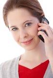 Retrato de la mujer joven en la sonrisa móvil Imagen de archivo