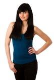 Retrato de la mujer joven hermosa en camiseta azul Imagenes de archivo