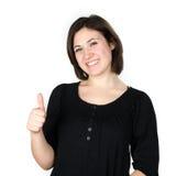 Retrato de la mujer joven que muestra sus pulgares para arriba Imágenes de archivo libres de regalías