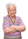 Retrato de la mujer mayor con las manos cruzadas imágenes de archivo libres de regalías