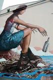 Retrato de la mujer pintado en la pared Fotos de archivo