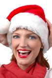 Retrato de la mujer que desgasta el sombrero de Santa Imagen de archivo