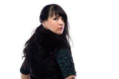Retrato de la mujer rechoncha en chaqueta de la piel, de la parte posterior Foto de archivo libre de regalías