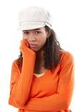 Retrato de la mujer triste en casquillo imagen de archivo