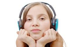 Retrato de la niña con el auricular azul, en blanco Imágenes de archivo libres de regalías