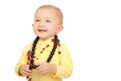 Retrato de la niña sonriente con los granos Imagen de archivo libre de regalías