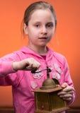 Retrato de la niña y de una amoladora fotografía de archivo libre de regalías