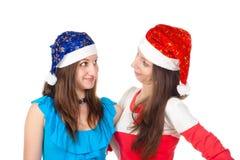 Retrato de la risa bonita de las muchachas de Papá Noel Fotografía de archivo