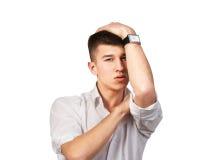 Retrato de la situación del hombre joven aislado en blanco Imagen de archivo libre de regalías