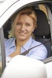Retrato de la ventanilla del coche femenina de Looking Out Of del conductor Imagen de archivo libre de regalías