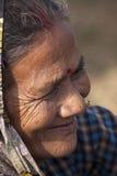 retrato de la vieja mujer del tharu, Nepal Imagen de archivo libre de regalías