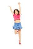 Muchacha de salto feliz en whtie Fotografía de archivo libre de regalías