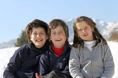 Retrato de los hermanos sonrientes del caucásico tres fotografía de archivo