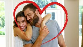 Retrato de los pares que abrazan en casa para el día de San Valentín almacen de video
